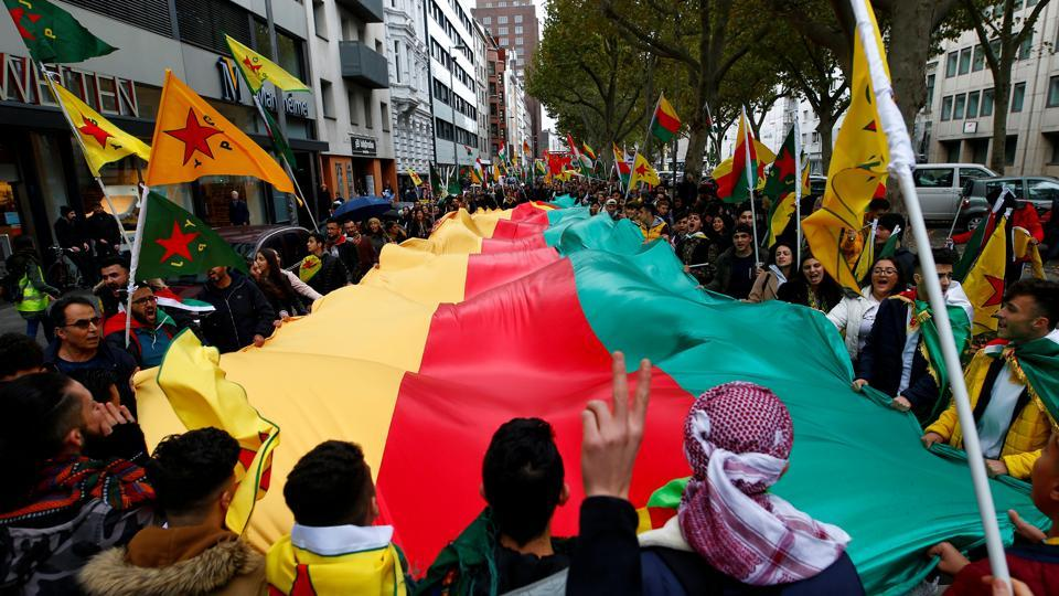 Pro-Kurdish demonstrators protest against Turkey's military action in northeastern Syria in Cologne, Germany.