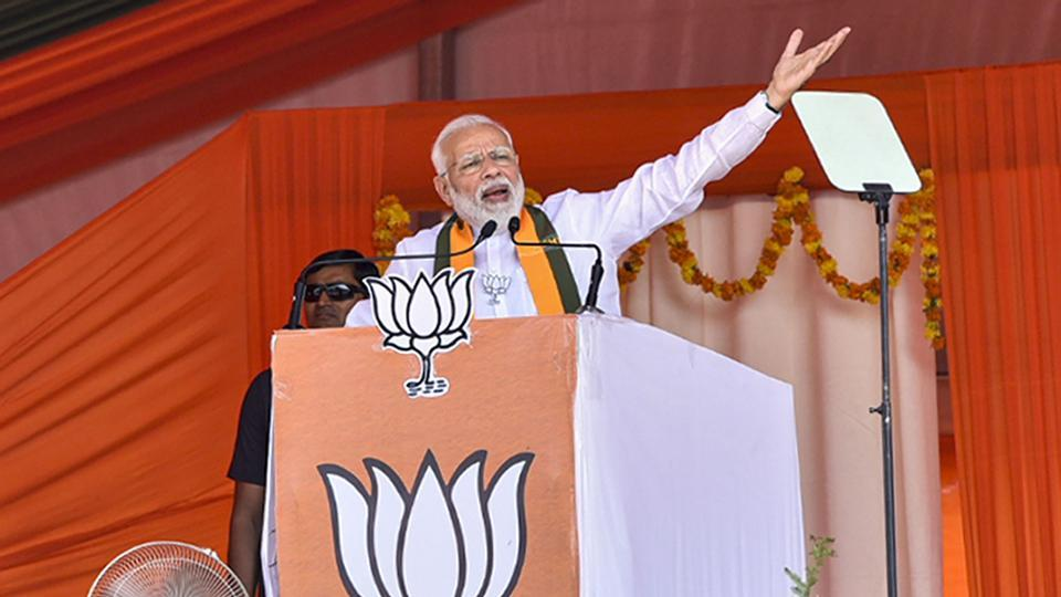 Prime Minister Narendra Modi gestures as he speaks during an election campaign rally ahead of Assembly polls in Haryana.