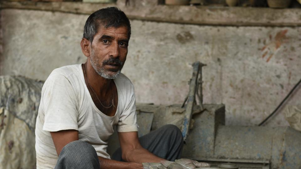 Potter Shayam Lal Prajapati makes diyas during the festival season, otherwise he ferries people on his cycle-rickshaw.