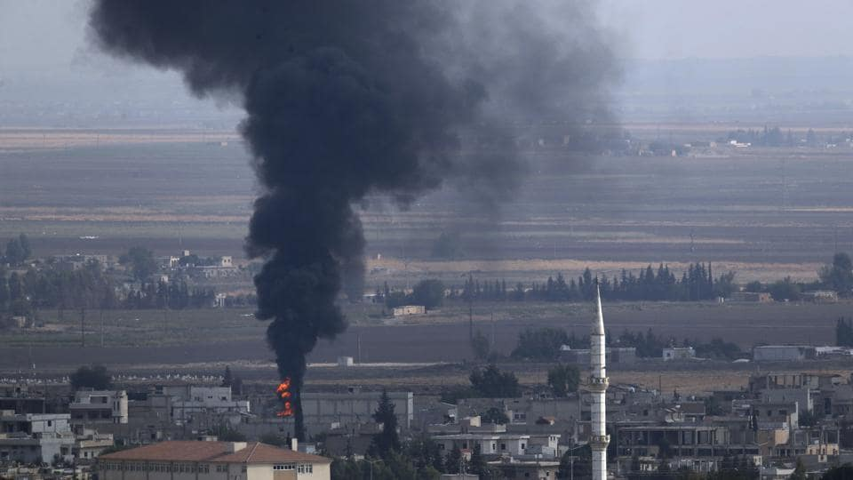 Smoke billows from a fire in Ras al-Ayn as fighting broke out  in the Syrian border town which has been a flashpoint in the fight between Turkey and Kurds.