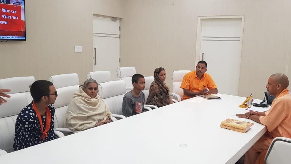 Family members of Kamlesh Tiwari meeting Uttar Pradesh Chief Minister Yogi Adityanath at his residence in Lucknow onSunday.