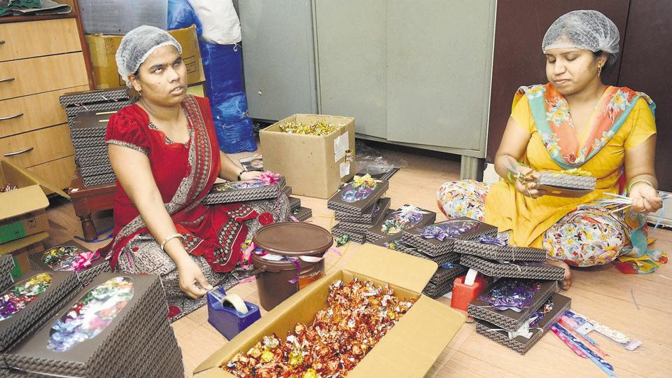 The girls of Niwant Andh Mukt Vasanalay packing chocolates in attractive boxes ahead of Diwali.