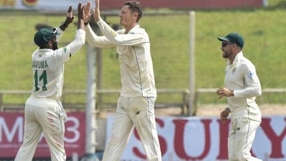 South Africa's bowler George Linde celebrates with teammates after dismissing Indian batsman Ajinkya Rahane.