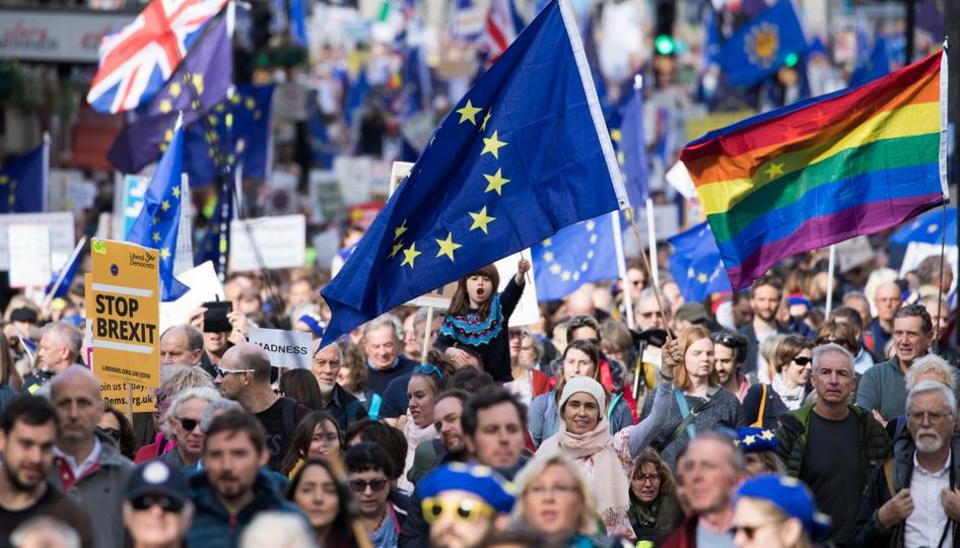 Demonstrators hold European Union (EU) flags and banners on Whitehall during a People's Vote march in London, U.K.