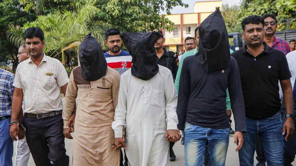 Gujarat Anti-terrorist squad (ATS) officers produce and hand over three suspect related to the murder of Hindu Samaj Party founder-leader Kamlesh Tiwari to UP Police, in Ahmedabad.