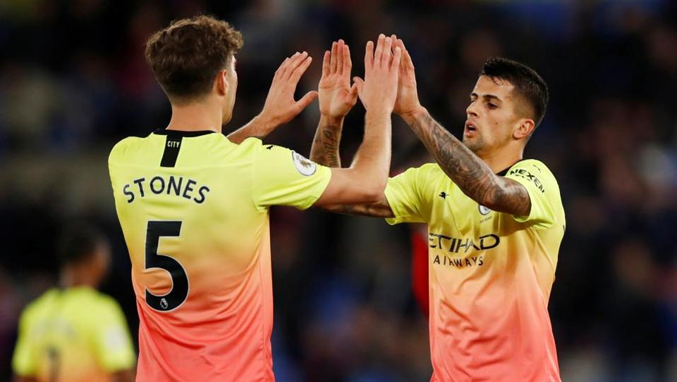 Manchester City's John Stones and Joao Cancelo at the end of the match