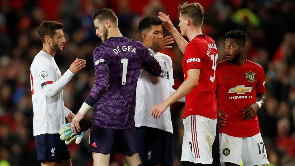 Liverpool's Adam Lallana shakes hands with Manchester United's David de Gea.