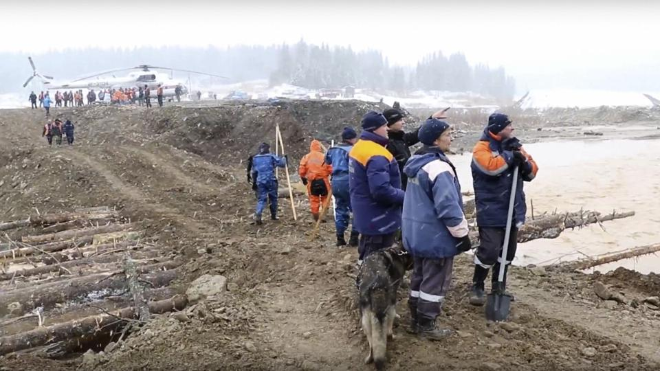 At least 15 people are dead after a dam at a small Siberian gold mine collapsed and water flooded two workers' dormitories on Saturday.