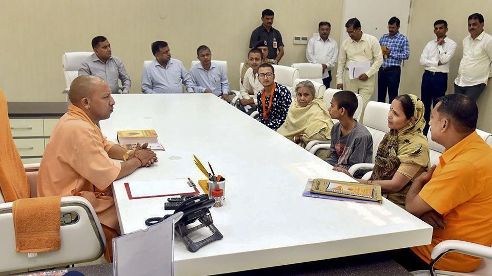 Family members of the slain Hindu Samaj Party chief Kamlesh Tiwari meet Uttar Pradesh Chief Minister Yogi Adityanath at his residence in Lucknow, Sunday, Oct. 20, 2019.