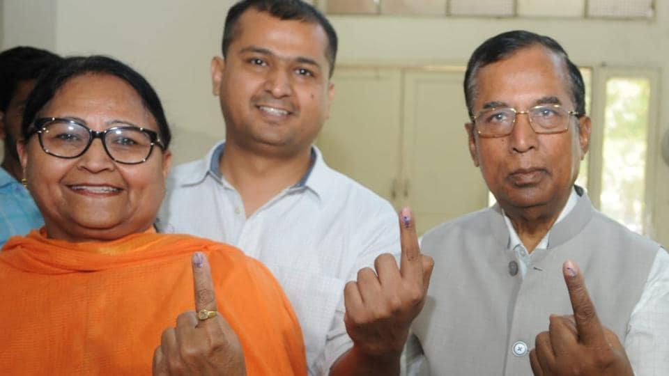 Union minister Som Parkash with his wife Anita Parkash and his son Sanjiv after casting their votes in Phagwara on Monday.