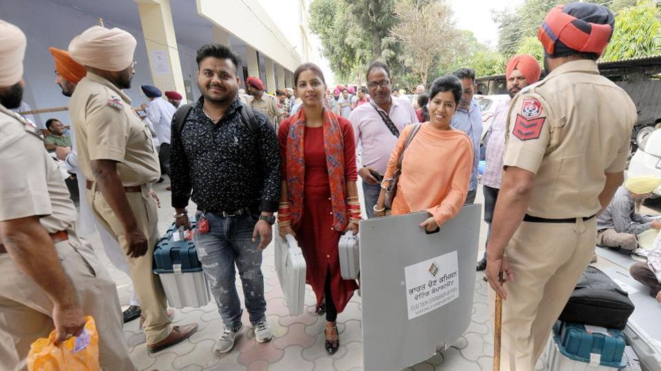 Election officials carry poll material in Phagwara on Sunday,  for assembly bypolls, October 20, 2019.