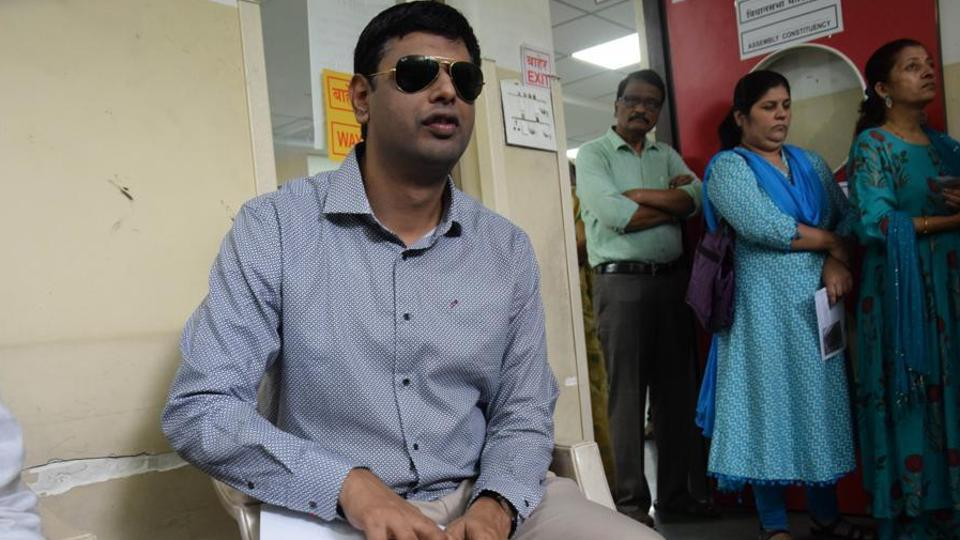 Bhushan Toshniwal, a blind chartered accountant, gets ready to cast his vote in Chinchwad on Sunday.