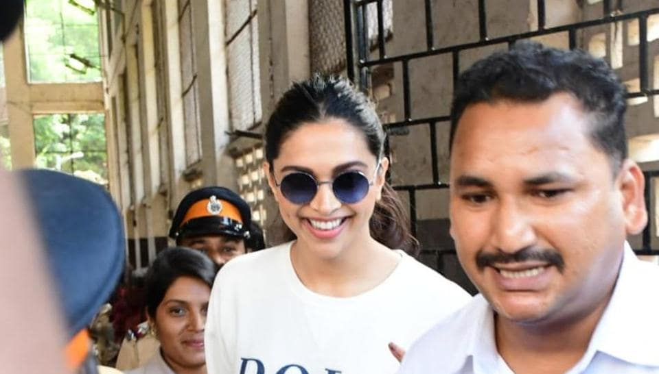 Deepika Padukone flanked by security at a polling booth. The actor cast her vote during the ongoing assembly elections. (All pics: Varinder Chawla)
