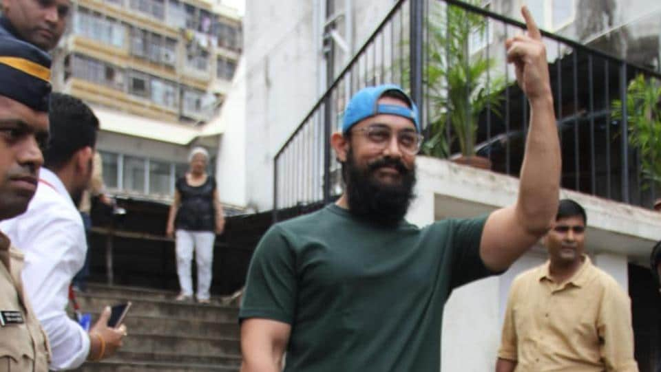 Aamir Khan shows his inked finger to the paparazzi.