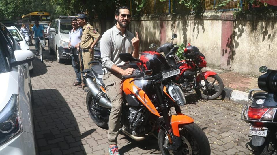 John Abraham arrived to vote on a bike.