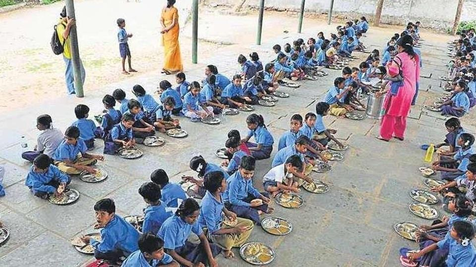 Children have a mid-day meal at a government school in Jaipur.