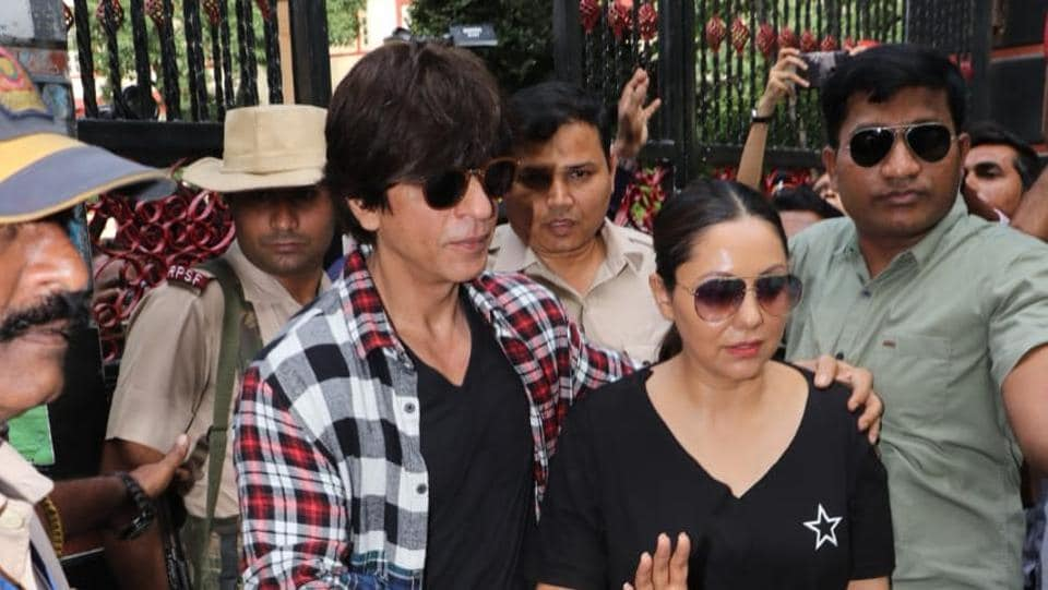 Shah Rukh Khan with wife Gauri Khan at a polling station.