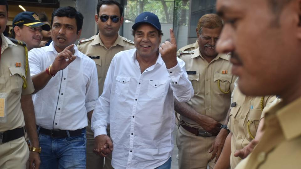 Dharmendra smiles after casting his vote.