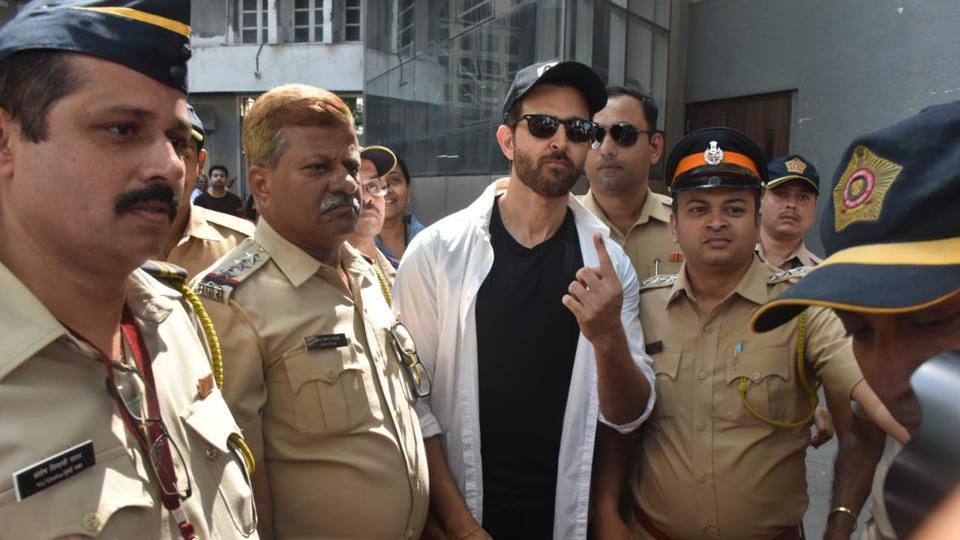 Hrithik Roshan with policemen at a polling station.
