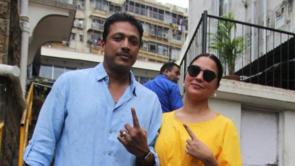 Lara Dutta with Mahesh Bhupathi. The two were among the early voters of the day.