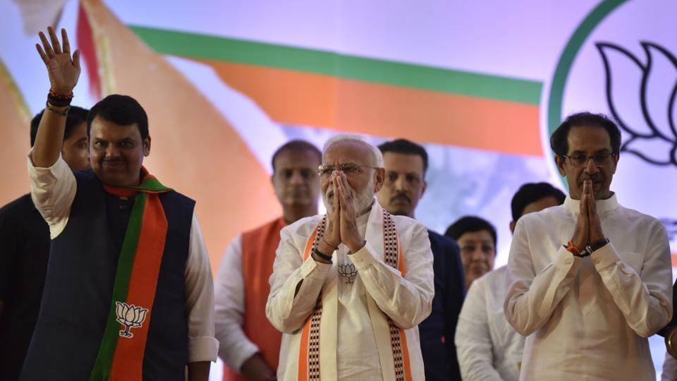 Prime minister Narendra Modi along with Maharashtra CM Devendra Fadnavis and Shiv Sena president Uddhav Thackrey during Maharashtra assembly election rally.