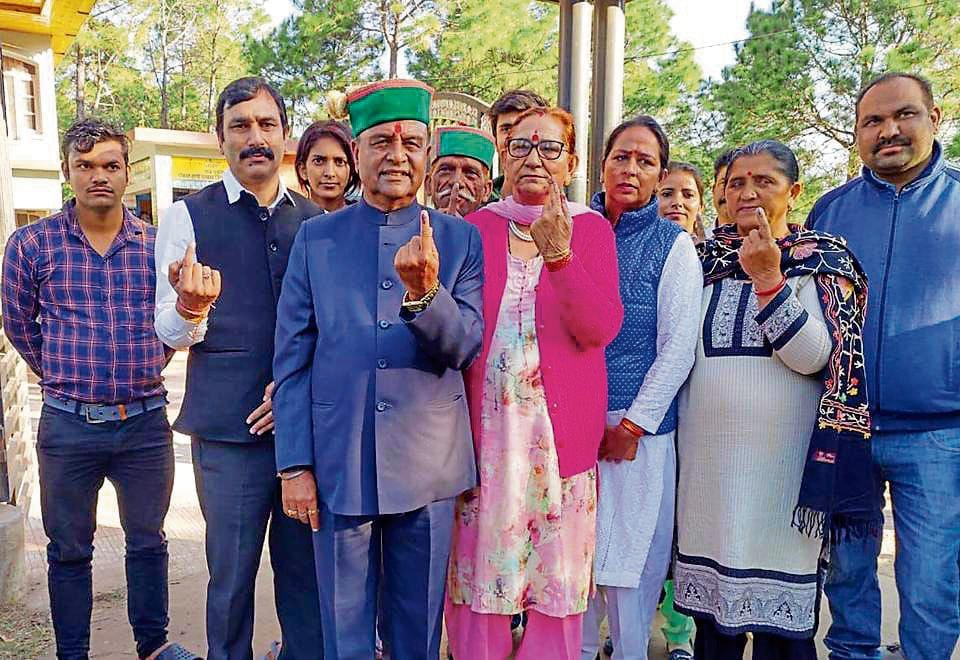 Congress candidate Gangu Ram Musafir with his family members and supporters after casting vote in the Pachhad constituency of Sirmaur district on Monday.
