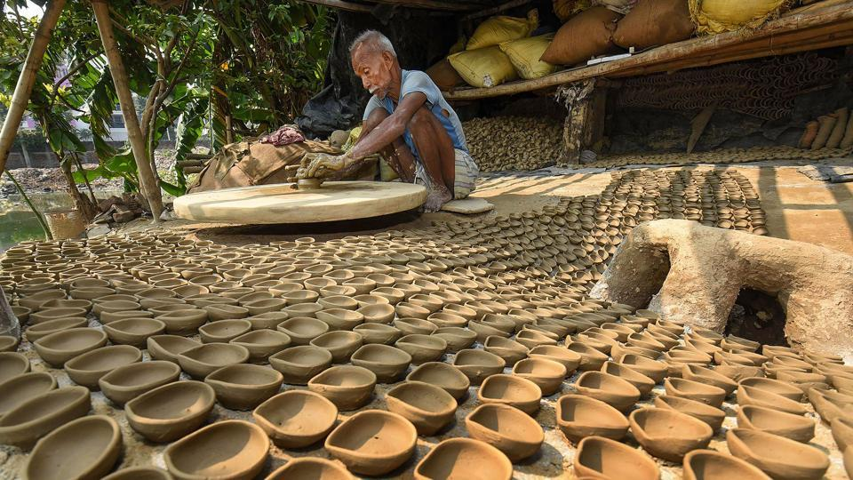 A potter makes traditional 'Diyas' (earth lamps) ahead of Diwali festival (representational image)