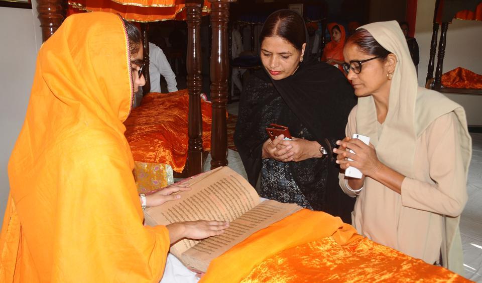 Devotees paying obeisance to Guru Granth Sahib at Punjabi University in Patiala on Monday.