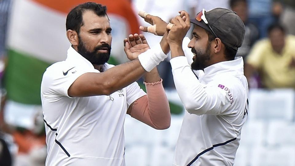 Ranchi: Indian bowler Mohammed Shami celebrates with teammate Rohit Sharma.