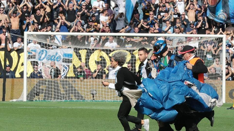 A parachutist who landed on the pitch during a Serie A  match.