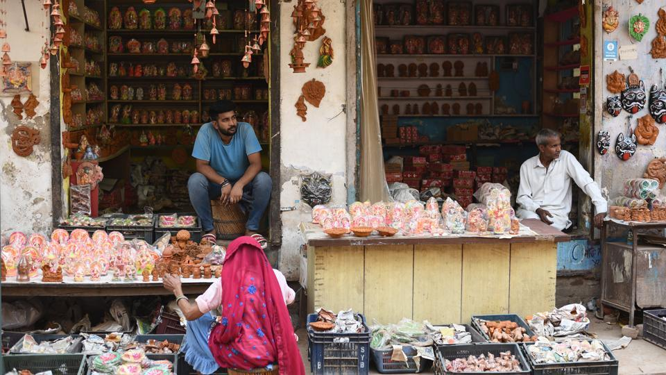"""A shop at potters' village at Bindapur, near Dwarka in New Delhi. While in the last few years, Kumhar Gram, India's largest potters' colony, has become a tourist hub, with several tour operators and guides bringing in foreigners for an """"unmatched cultural experience"""", the potters there are struggling for survival. Diwali, the biggest sale season, has failed to bring any cheer their way. (Vipin Kumar / HT Photo)"""