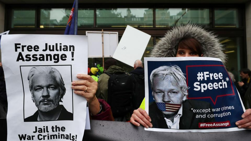 Demonstrators hold placards during a protest outside of Westminster Magistrates Court, where a case management hearing in the U.S. extradition case of WikiLeaks founder Julian Assange is being held.