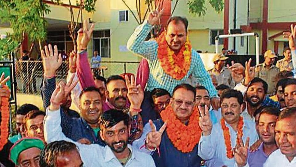 A winner celebrates his win with his supporters after announcement of results for Uttarakhand panchayat polls, Monday, October 21, 2019.