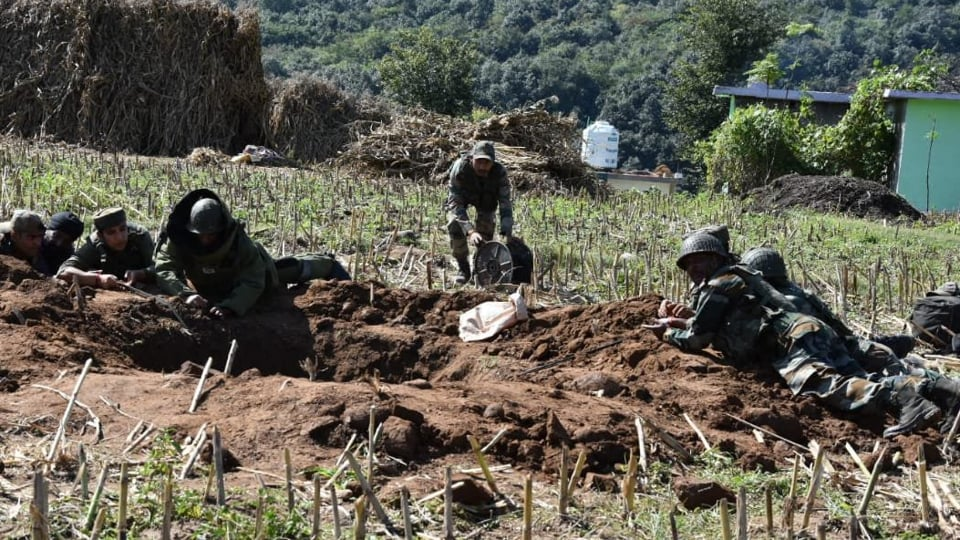 Indian Army jawans defusing mortars fired by the Pakistan side in the recent ceasefire violation in Karmara village of Poonch in Jammu and Kashmir.