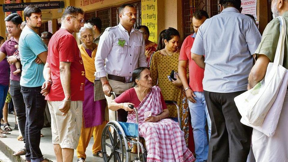 A senior citizen on wheelchair cast vote during Maharashtra assembly election at Municipal School,Kandivali in Mumbai, on Monday, October 21, 2019.
