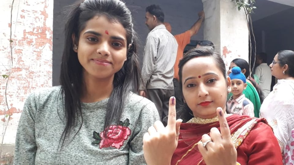 Two voters after casting their votes during assembly bypoll in Phagwara, Punjab, on Monday, October 21, 2019.