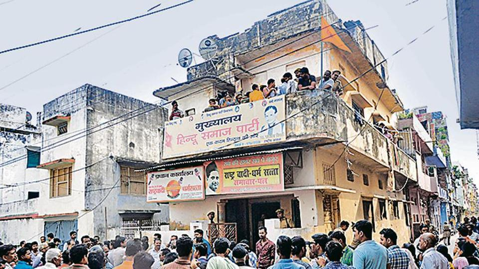 A large crowd gathered near the office of Kamlesh Tiwari, a leader of a local Hindu outfit who was found murdered, in Lucknow, Uttar Pradesh.