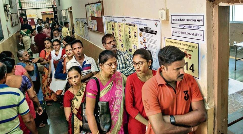 Voters wait for their turn at a polling booth in Worli during the Maharashtra assembly election, October 21, 2019.