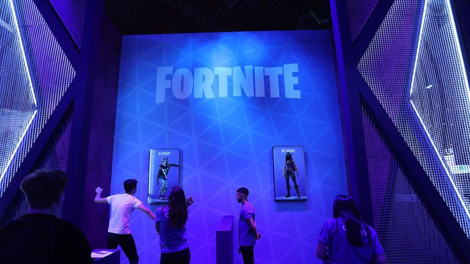An attendee performs a 'floss' dance on the Epic Games Inc. Fortnite video game stand at the Gamescom gaming industry event in Cologne, Germany