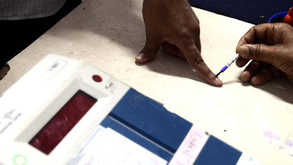 A polling officer applies ink to a voters finger after he casts his vote at a polling booth in Pune Cantonment assembly constituency.  The constituency witnessed a lukewarm voter turnout in the first half of the day.