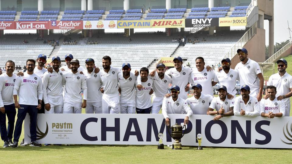 Indian captain Virat Kohli and team players pose with the trophy. (PTI)