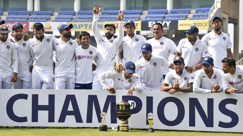 Ranchi: Indian captain Virat Kohli and team players pose with the trophy.