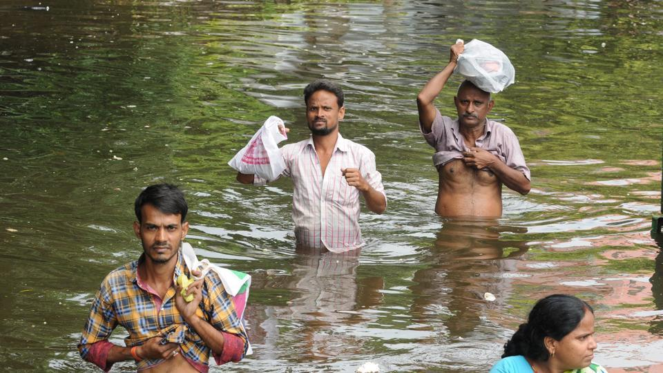 People move to safety on the sixth day of water logging after heavy rain at Rajendra Nagar, Patna, October 3, 2019