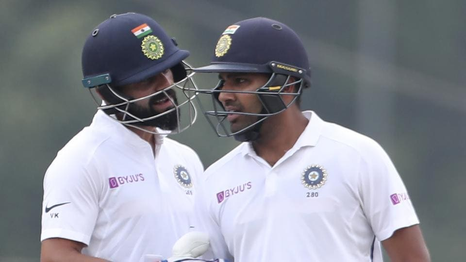 India skipper Virat Kohli speaks to Rohit Sharma during Ranchi Test.