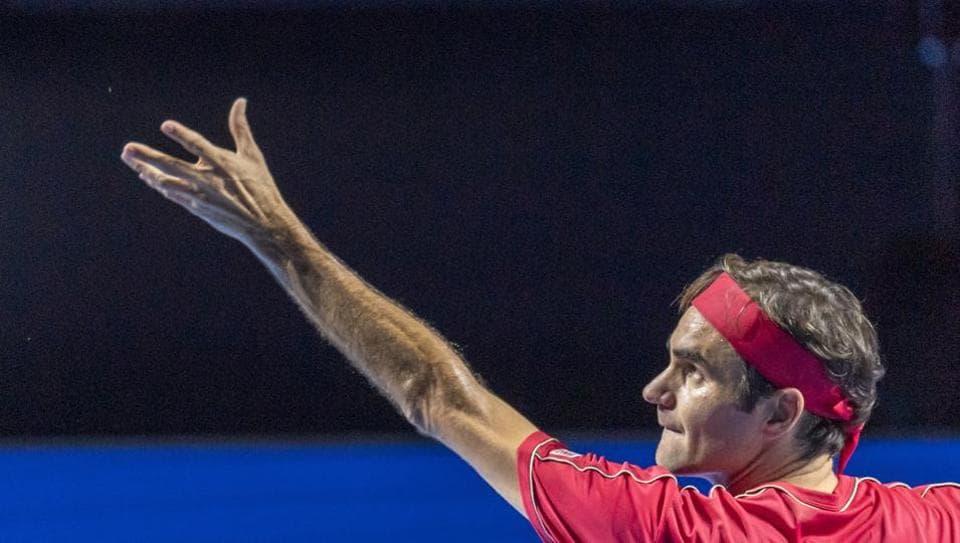 Switzerland's Roger Federer serves to Germany's Peter Gojowczyk.