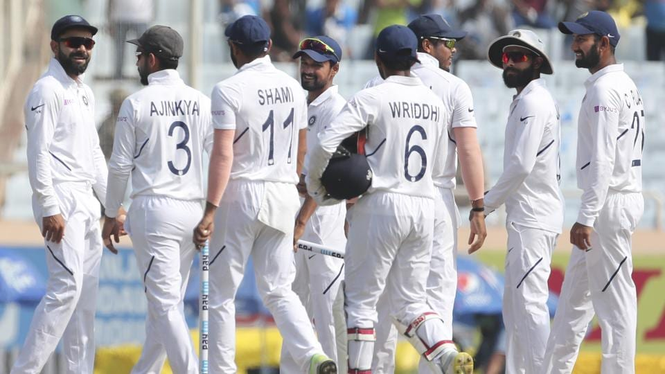 India's captain Virat Kohli, left, and teammates celebrate after their win.