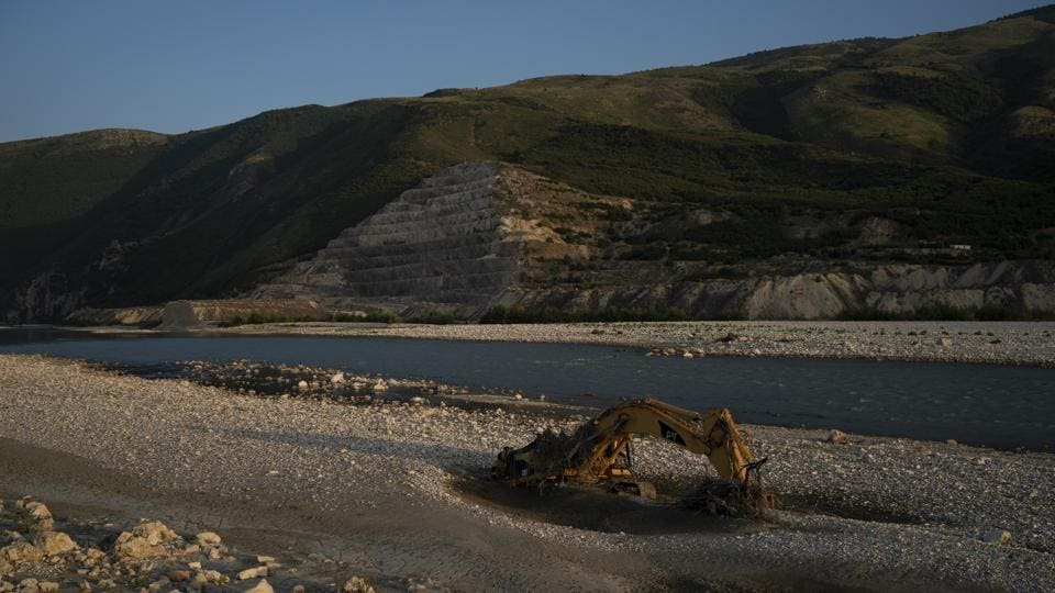 An abandoned bulldozer sits on the banks of the Vjosa River at the construction site of the Kalivac dam in Albania. With an aim to produce much-needed electricity for one of Europe's poorest countries, the government has set in motion plans to dam the Vjosa and its tributaries. Vjosa, which is one of Europe's last wild rivers, runs the risk of interruption in its flow and the life in and around it. (Felipe Dana / AP)