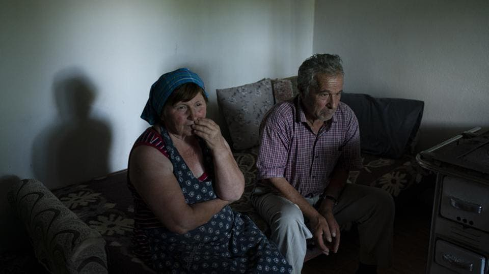 "Jorgji Ilia, 71, a retired schoolteacher, sits with his wife, Vito, 64, inside their home in the village of Kanikol, Albania. ""There is nothing else better than the river,"" he said. ""The Vjosa gives beauty to our village."" Those who live along the riverbank or rely on the waterway for their livelihood fear dams could kill the river. Its fragile ecosystem will be irreversibly altered, and many residents will lose their land and homes. (Felipe Dana / AP)"
