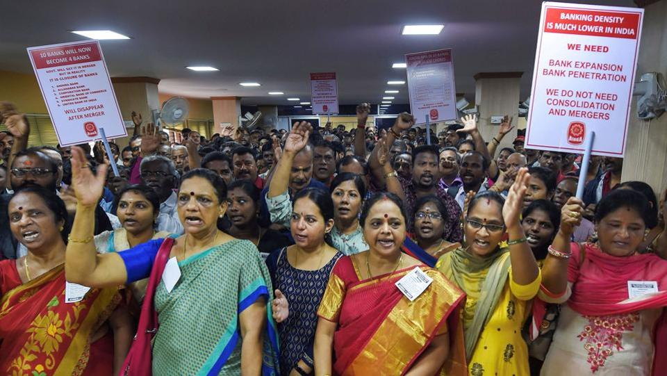 Bank employees stage a protest by holding placards inside the premises of a bank in Chennai, Tamil Nadu. The government has vowed to cut the total number of state-owned banks to 12, from 27 in 2017, raising fears of job losses. Under the current round of squeezing, 10 banks will be amalgamated into four. The sector suffered from out-of-control lending in 2006-11 when the economy grew rapidly, and has continued to struggle. (PTI)