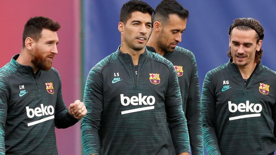 SBarcelona's Lionel Messi, Luis Suarez, Sergio Busquets and Antoine Griezmann during training.